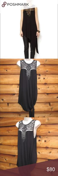 "NWT Free People Saturn Moon  Jersey Tunic Free People Saturn Moon Sleeveless Jersey Tunic, Size M, New with Tags  Details: Free People Size: M Color: Black Accented with embroidery, this Free People tunic flaunts feminine free spirit in an asymmetric silhouette. Embroidered crewneck, sleeveless, asymmetric hem, v back Viscose Machine wash Measurements: Length: 33"" at shortest length: Bust: 40"" Waist: 40"" Free People Tops Tunics"