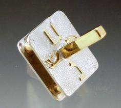 gold and silver dreidel