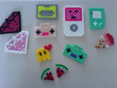 These are cute little Perler/Hama beads necklaces and keychains that my daugther and I crafted for our yard sale. Beads necklaces and keychains Perler Bead Designs, Pearler Bead Patterns, Perler Bead Emoji, Diy Perler Beads, Bead Crafts, Diy And Crafts, Crafts For Kids, Pixel Art, Beading For Kids