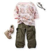 A pink vintage floral top and olive utility pants are an on-trend paring she'll love. Boots with pink laces and a head wrap complete this look.