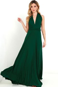 """As Seen On Kyrzayda of Kyrzayda blog! Versatility at its finest, the Tricks of the Trade Forest Green Maxi Dress knows a trick or two... or four! Two, 74"""" long lengths of fabric sprout from an elastic waistband and wrap into a multitude of bodice styles including halter, one-shoulder, cross-front, strapless, and more. Stretchy jersey knit hugs your curves as you discover new ways to play with this fascinating frock. Full, maxi-length skirt has a raw hemline. Want Styling Tips? <a href..."""