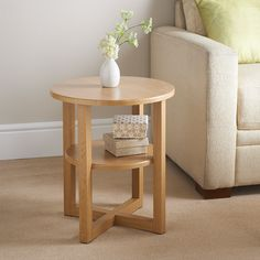 Milton Side Table. Oak finish side table. Contemporary round shaped side table with undershelf. Accessories not included. Dimensions: W50 x H50cm (Approx.)