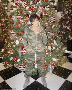 Lost in the tinsel: The momager certainly blended into the scenery in that camouflage ones...
