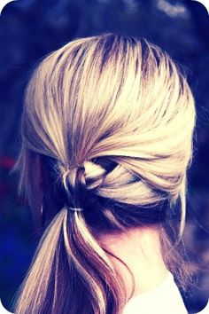 knotted ponytail: Apply a light holding mousse to your hair from rootsroots to ends. Then separate the hair over your shoulder into two sections. The section from the back should come forward and down. Then tie the two section into a simple knot. Secure the two ends together using a clear elastic. Once it's in there, slide it up underneath the knot to conceal it and done!