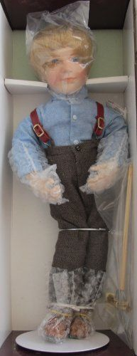 "LITTLE HOUSE on the PRAIRIE Porcelain ""ALMANZO"" WILDER DOLL 16"" w SHIPPER (1993 ASHTON DRAKE) by Ashton Drake, Artist Joan Ibarolle. $319.99. Little House on the Prairie Almanzo is a 1993 Ashton Drake production, by Artist Joan Ibarolle.. Almanzo (Wilder) Doll is approx. 16"" tall with blond hair & blue eyes. Doll wears a Pair of brown Pants w/suspenders, a blue long sleeve Shirt w/small buttons, a Pair of brown Shoes, & comes with a Pitch Fork, some Hay, a Doll Stand for D..."