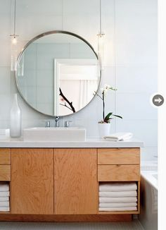 To da loos: Large round mirrors in the bathroom - my latest obsession