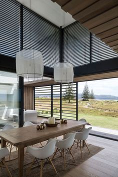 The dining area is characterized by the double-height ceiling.
