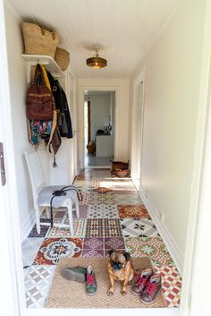 Mismatched tiles looks like a quilt on the floor... cool idea for a hallway...