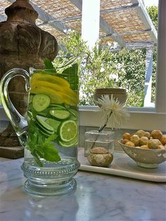Karen's vitamin water...  cucumber, lemon, lime, and mint- add water.  Beautiful way to hydrate! Diuretic and detox properties.  Pour a glass and simply replace with more H2O.  In the fridge or on the counter, like a lovely bouquet.  Thanks Karen by donnasbrightman, via Flickr
