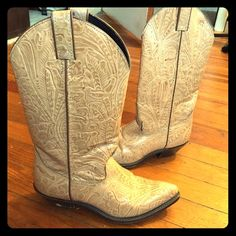 Vintage tan leather tooled floral design boots Vintage tan leather floral design cowgirl boots, vintage worn condition but no wearability affecting flaws in the leather, soles, etc. (I will also rub these down with some saddle soap before I send them out to you). Size 6 1/2. Code West brand, made in the USA genuine leather. Vintage Shoes Heeled Boots