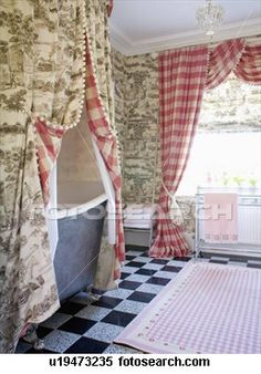 Grey Toile-de-Jouy curtains above bath in bathroom with red checked View Large…