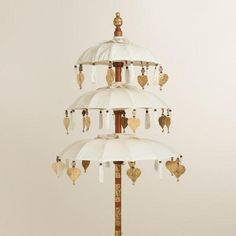 One of my favorite discoveries at WorldMarket.com: 3 Tier Balinese Umbrella