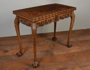 Carved mahogany Chippendale style card table Origin: English Circa 1900