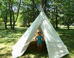 I think this is the best tipi how-to I've seen.  No sewing, very little fuss.  Step-by-step photos too.