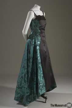Lanvin  dress 1939 . Made in metallic green brocade and black silk taffeta . Museum at FIT New York.