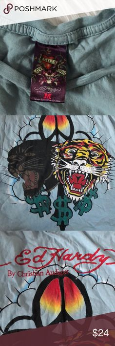 Ed Hardy Tiger Graphic Muscle Tank Top Excellent condition with little to no wear and tons of life left! Same day/next day shipping. Only flaw is in the top corner you can barley tell. NO TRADES PLEASE Ed Hardy Tops Tank Tops