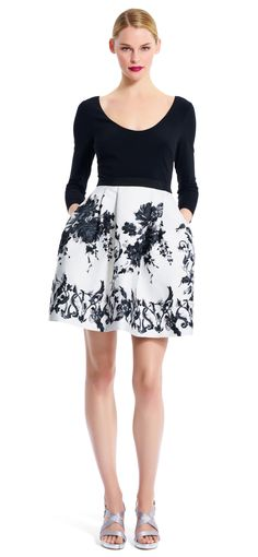 A soft, scooped neck jersey bodice gives way to a full floral jacquard skirt, featuring a floral print throughout.