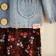 Details of our cotton pumps and the wool&cotton cardigan :) #queenzoja #sew #sewing #cotton #pumps #pants #flowerprint #flowers #wool #handmade #knitted #knitting #cardigan #jumper #sweater #kidsfashion #kids #madeinpoland #wooden #button #nofilter #nofilters