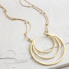 One of my favorite discoveries at WorldMarket.com: Gold Crescent Pendant Statement Necklace