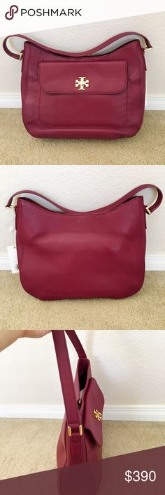 """Tory Burch red slouchy  hobo purse/ handbag Original price $495 plus tax. Brand: Tory Burch. Condition: brand new with tag. Color: Shiraz (plum red). Style # 31386. Very gorgeous Tory Burch Mercer Slouchy Hobo bag is made from soft pebbled leather. The front of the bag features the gold Tory Burch signature """"T"""" turn lock with front pocket. There are 2 slip pockets and 1 zip pocket inside. Major compartment with magnetic snap closure. Strap drop about 9"""" Measurements : 10"""" H x 14"""" L x 4"""" W…"""
