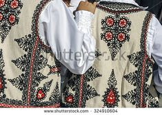 Friendship between two people who wears traditional costumes Romanian specific area Banat, Romania. - stock photo