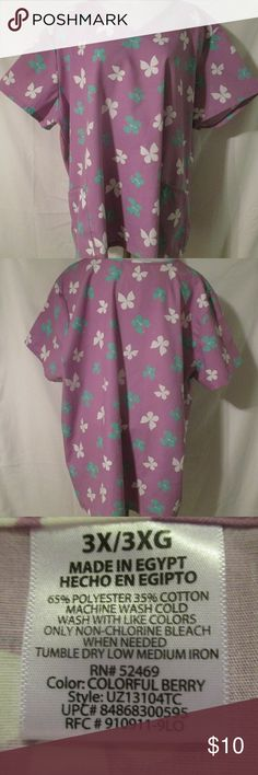 """Plus Size Printed Purple Butterfly Scrub 3X Nice looking women's plus size scrub top that is in very good condition with only gentle wear. Stated size is 3X. Measurements are 21"""" shoulders, 30"""" chest, 8.5"""" sleeve, 30"""" tail. SB Scrubs Tops"""