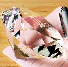 Diamond Paper Weight.  Diamonds are a girl's best friend...especially big ones! This unique multi-faced diamond shaped optical crystal paperweight is perfect in color, cut and clarity. It can be laser engraved with personalization, too!