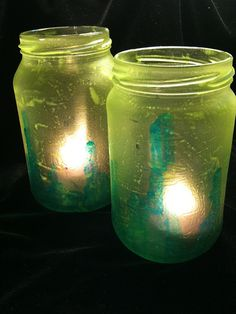 Just a couple of jars I painted with a mixture if acrylic glazing medium and food coloring. I may dress them up with som wire & beads, but right now I like them just the way they are.