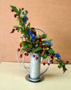 """A Traditional Small design by Sharon Ware. Class title: """"A Tin Club Can be Used for Many Different Things."""" 1st place at 2012 Ohio Association of Garden Clubs Annual Convention."""