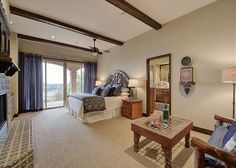 Luxurious king size bed with incredible fire place and a breathtaking view! - Turnkey Vacation Rental