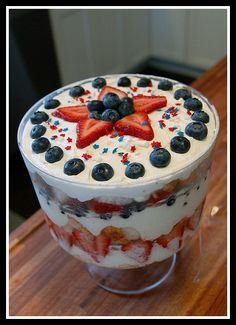 World's easiest Fourth of July trifle: Cubed up angel food cake layered with strawberries, blueberries, and a mixture of cool whip and lemon curd. So light and refreshing on a hot day!