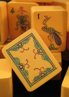 1930s Chinese Bakelite white dragon mahjong tile. The design is taken from the tops of a bamboo sprout. Mah Jongg.