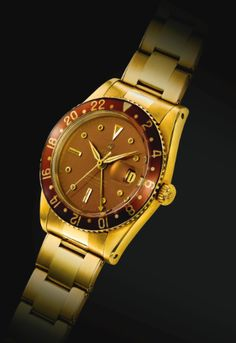 Rolex   AN EXTREMELY FINE AND RARE YELLOW GOLD AUTOMATIC DUAL TIME ZONE WRISTWATCH WITH DATE, CENTER SECONDS, BAKELITE BEZEL AND BRACELET REF 6542 CASE 424243 GMT-MASTER CIRCA 1958   Sotheby's