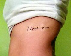 "Rib Tattoo: ""I love you"" written by husband. Husband has same words written by wife on ribs. Anniversary Present."