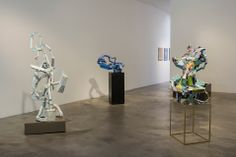 Maura Bendett. Installation View of Vespid Empire. From Right: Tall Sculpture, 2013; Blue Sculpture, 2013; and White Edging, 2013.