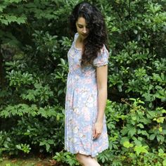 Upcycle a thrifted dress with this easy DIY! An old floral dress is transformed into a new garment with a few snips and seams.