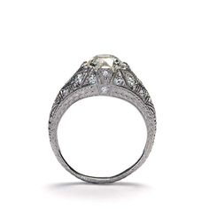 US$14,500 Stock Number: VR171116-3 Center old european cut diamond weighs 1.75 carats, K color and VVS2 clarity with GIA report #6173570247. set in a stunning slender domed ring studded with twenty two round bead set diamonds, gorgeous filigree lines and detailed hand engraving on the sides and down the band. This beauty is an original Early Art Deco Engagement ring. Currently size 8 1/2.