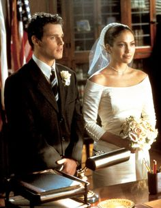 Although theirs isn't a match made in heaven, we love the courthouse wedding dress Mary (Jennifer Lopez) wears, from the off-the-shoulder neckline to the three-quarter sleeves to the pillbox hat with veil. Source: Sony Pictures
