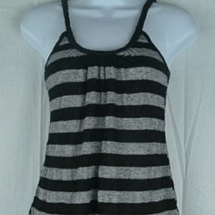 Black And Grey Horizontal Striped Flowy Tank Top This is an awesome tank top from Julie's Closet. It has black and grey horizontal stripes all over it and the bottom of the front and back are longer than the sides, and is flowy. The straps are black and braided. There are no flaws on this top and it is a size small. #tanktop #braided Julie's Closet Tops Tank Tops