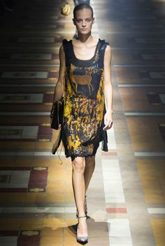 Spring 2015 Ready-to-Wear - Lanvin  -- Art deco flapper style, knee-length dress with gold biches / deer or gazelle and foliage on dark background.