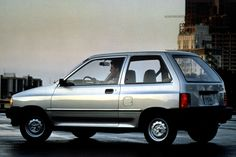 FORD FESTIVA If you've ever had the misfortune of having to drive around with a… Ford Festiva, Kia Pride, Chevrolet Cavalier, Ford Escort, Car Advertising, Henry Ford, Fuel Injection, Ford Motor Company, Manual Transmission
