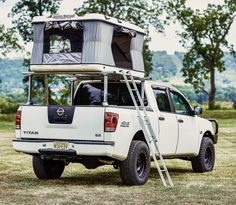 The James Baroud Explorer Evolution rooftop tent offers all the features of the Evasion with additional storage on the rear of the upper shell. Truck Tent, Truck Camping, Tent Campers, Camper Trailers, 2005 Nissan Titan, Nissan Trucks, Nissan Navara, Roof Top Tent, Camper Life