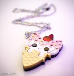 Ice Cream Cone Kitty Pendant/Necklace With Swarovski Crystal Sprinkles Laser cut layered acrylic. $25.00, via Etsy.