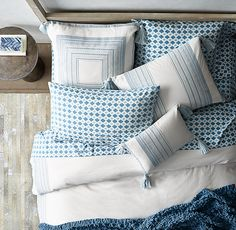 RH TEEN's Milly Duvet Cover:Not your grandmother's needlepoint. We gave the traditional embroidery sampler some edge by using a high-contrast palette to better illustrate stitchery's graphic sensibility. Corner tassels add a youthful flourish.