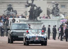 Catherine and William drive out of Buckingham Palace in an Aston Martin.