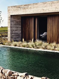 Concrete with wood look pressed in on pour, plus contrast with wood and stone (& water)