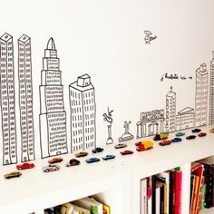 """The mural is a """"sticker"""" available from lesenfantsdudesign.com but you can DIY with Washi tape (or use blackboard paint and neon chalk - and change it as you like)"""