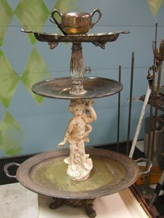 Lisa Loria  silver tray - interesting combination of items.  The little statue makes it fun!