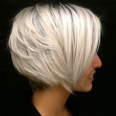 Stacked White Blonde Bob A stacked bob is so popular that sometimes it can become too expected in some circles. This style is perfect for women who are already sporting a layered blonde bob hairstyle and are growing weary of it. Get your layers feathered in the back to provide texture, while keeping the sections in the front straight and angled. It's a simple change that breathes new life into your look.
