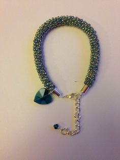 Kumihimo beaded bracelet with crystal charm
